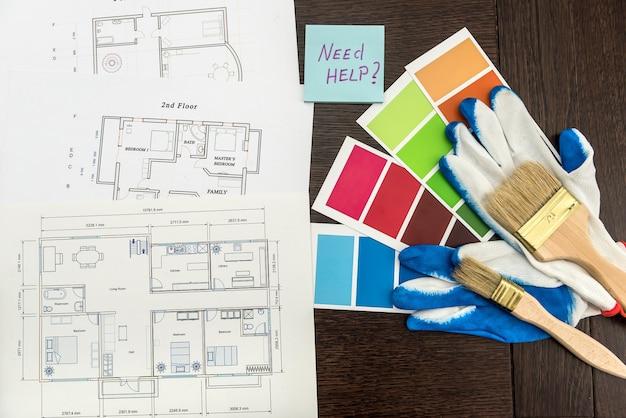 Szkic mieszkań domowych z naklejką potrzebuje pomocy tekst i katalog kolorów, ołówek i pędzel