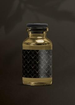 Szklana butelka do wstrzykiwania witaminy z luksusową czarną etykietą do pakowania produktów zdrowotnych i wellness wellness