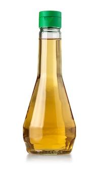 Szklana butelka octu na białym tle
