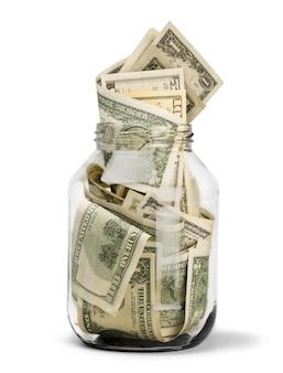 Szklany słoik na pieniądze na tle