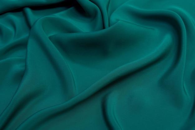 Szmaragdowy kolor tkaniny jedwabne fale tekstury