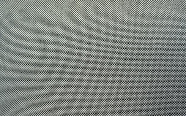 Szorstka tekstura tkaniny na wzór lub tło, zbliżenie na dywan jutowy jako tło, tło z dzianiny w jasnoszarym odcieniu
