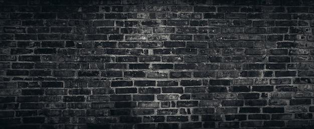 Szorstki czarny ściana z cegieł tekstury tło