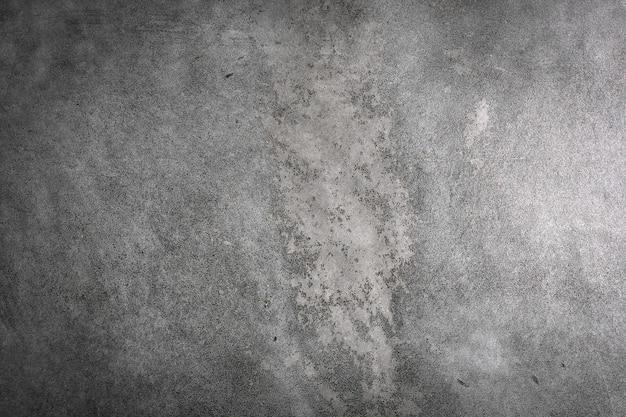 Szorstki materiał cementowo-szarej ściany. ziarnista powierzchnia abstrakcyjnego pustego tła dla przestrzeni kopii