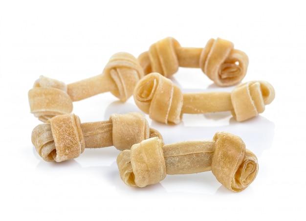 Sztuczne kości dla psa na białej ścianie