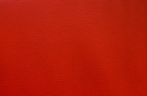 Sztuczny czerwony skóry zakończenie w górę tekstury tła małego wzoru