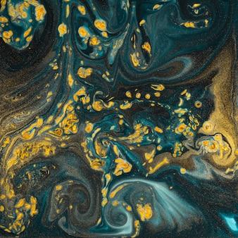 Sztuka abstrakcyjna tekstury farby. naturalny luksus. niebieska farba ze złotym brokatem. marmur.