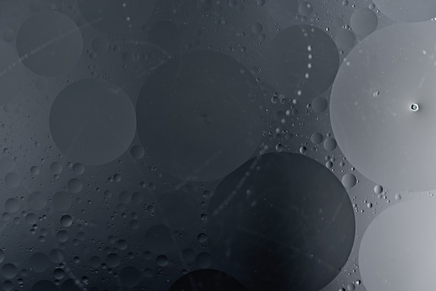 Sztuka czarne kółka na ciemnym tle, modna gotycka tekstura