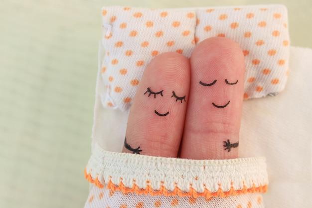 Sztuka palca szczęśliwej pary. para śpi w łóżku.