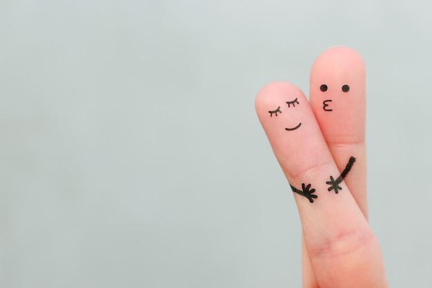 Sztuka palce szczęśliwej pary. mężczyzna przytula i całuje kobietę.