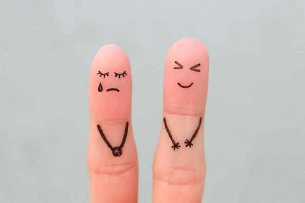Sztuka palców pary. kobieta płacze, mężczyzna się śmieje.