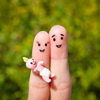 Sztuka palec szczęśliwej pary. szczęśliwa rodzina trzyma małe dziecko