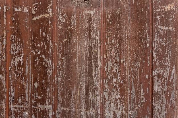 Sztuka tekstura drewnianej czerwonej farby pęknąć. zbliżenie.