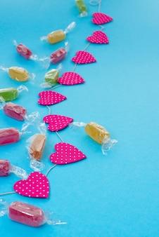 Tło uroczysty z Bright girlandy konfetti Candy.