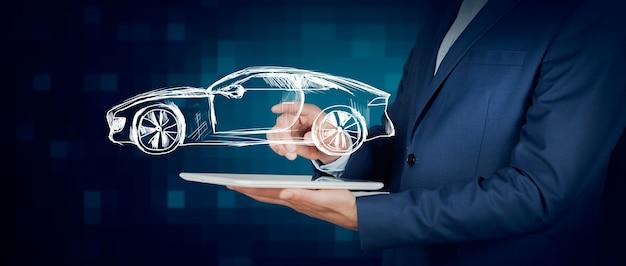Tablet ręka człowieka z modelu samochodu na ekranie