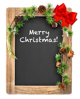 Tablica z dekoracją świąteczną i kokardą z czerwoną wstążką. rocznika tablica z przykładowym tekstem wesołych świąt!