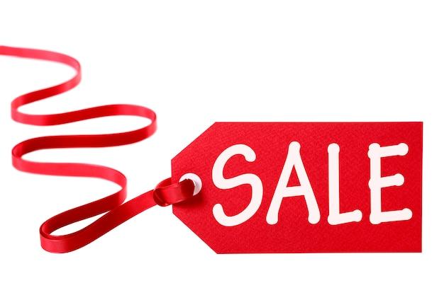 Tag cena sprzedaży z czerwoną wstążką