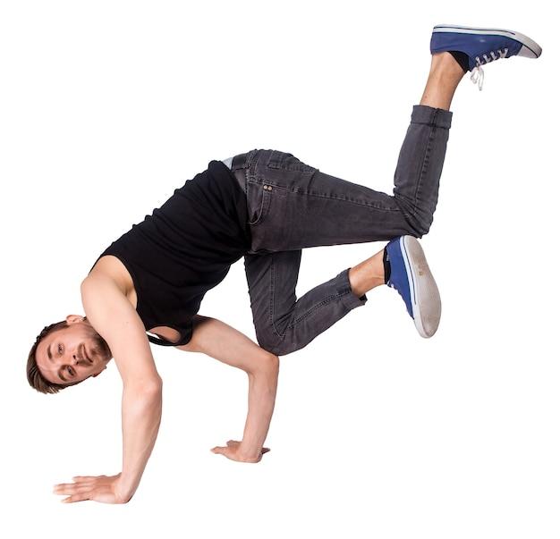 Tancerz break robi handstand na białym tle