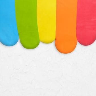 Tęczowa glina teksturowane tło kolorowe obramowanie w szarej kreatywnej sztuce diy
