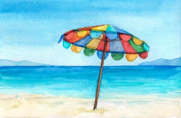 Tęczowy parasol na cudownej tropikalnej plaży.