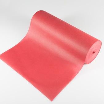Tekstur rolki barwiona opakowanie folia odizolowywająca na białym tle