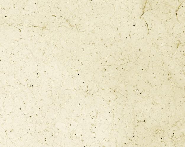 Tekstura arkusza papieru makulaturowego w sepii