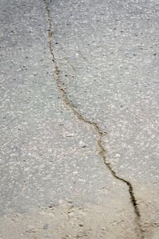 Tekstura asfaltu. pęknięty tekstury nawierzchni asfaltowej. pęknięcie asfaltu w tle
