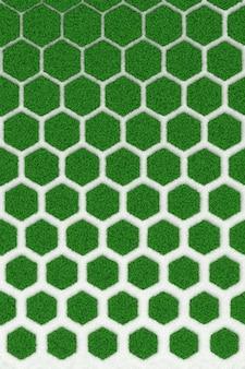 Tekstura betonowy honeycomb przerastający zielony gazon. 3d ilustracja