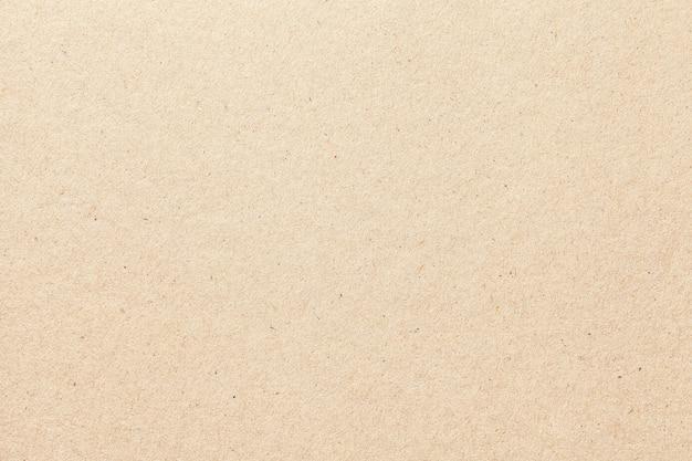 Tekstura beżowego starego papieru, zmięte tło. tło powierzchni vintage biały grunge