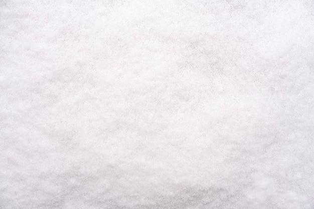 Tekstura białego świeżego śniegu. tło zima