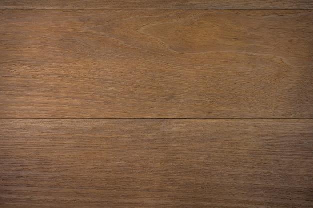 Tekstura brązowe drewniane powierzchni tła. kąt widzenia z góry.