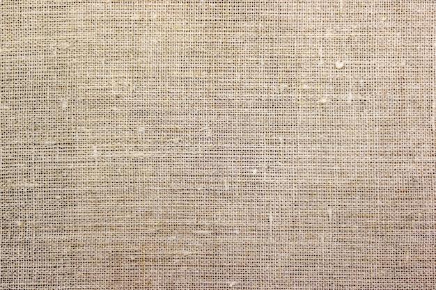 Tekstura brązowego płótna. tło z naturalnej tkaniny