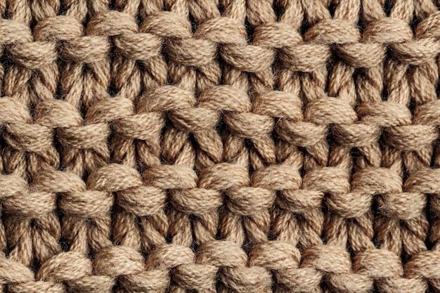 Tekstura brązowej dzianiny. odzież dziana i zimowa