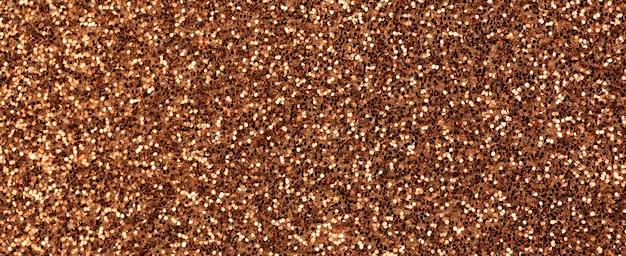 Tekstura brązowy brokat. tło transparentu. bardzo szczegółowe, makro, abstrakcyjne światła brokatowe na nowy rok, świąteczne dekoracje i uroczystości. zdjęcie koncepcji graficznej