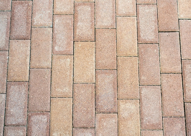 Tekstura brązowy kamienny bruk z bliska