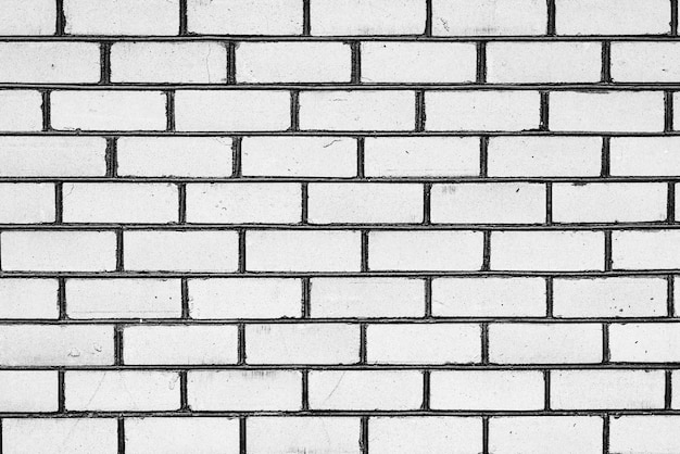 Tekstura, cegła, tło ściany. cegła tekstura z zadrapaniami i pęknięciami