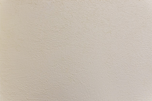 Tekstura cementowa ściana, powierzchnia wytłaczać ostry i szorstki wzór betonowy tapetowy tło. beżu tłoczony tło. betonowa ściana