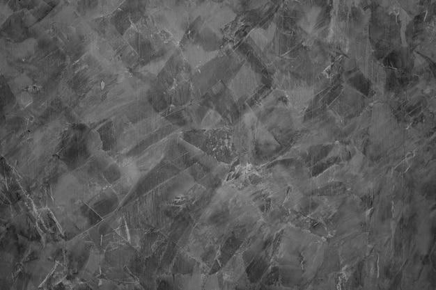 Tekstura cementu, czarne tło, streszczenie