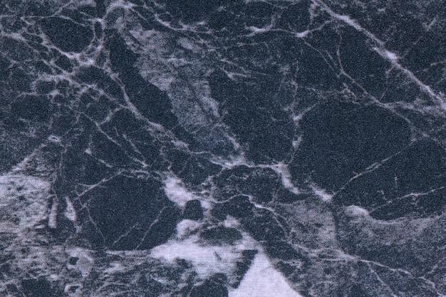Tekstura ciemnoniebieskiego i szarego marmuru, tło makro.