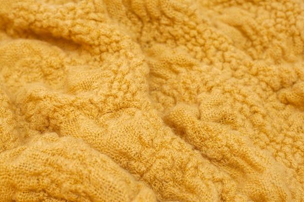 Tekstura ciepłej dzianiny w kolorze żółtym