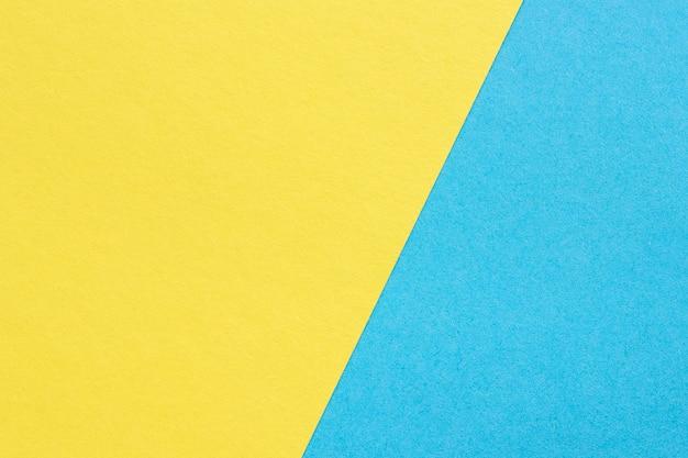 Tekstura ciężki papier, abstrakcjonistyczny kolor żółty i błękitny tło