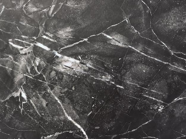 Tekstura czarnego marmuru z białymi liniami, tło makro