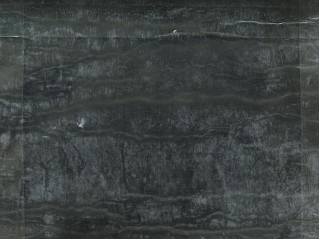 Tekstura czarnego porysowanego tła polietylenowego