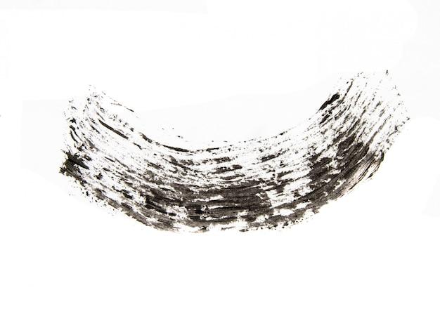 Tekstura czarnego tuszu do rzęs na białym tle