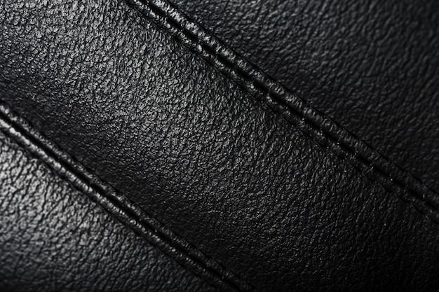 Tekstura czarnych skórzanych krzeseł szwy zamykają się.