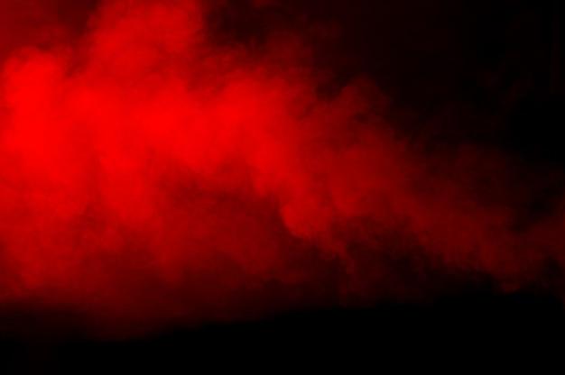 Tekstura czerwony dym na czarnym tle