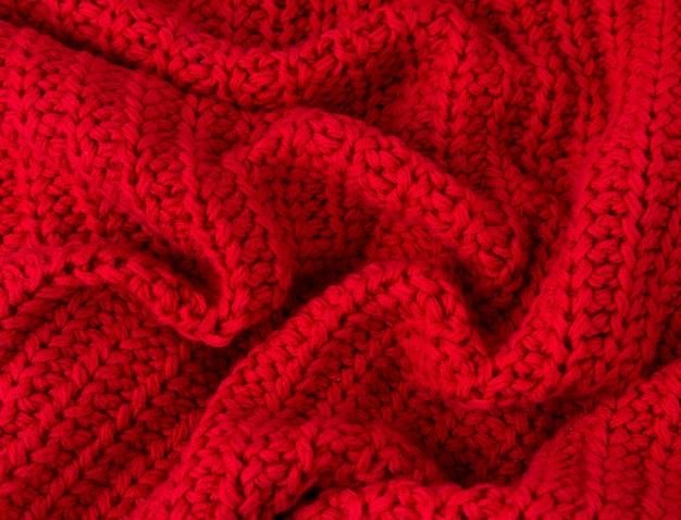 Tekstura czerwony trykotowy tkaniny zakończenie up. dzianina wełniana