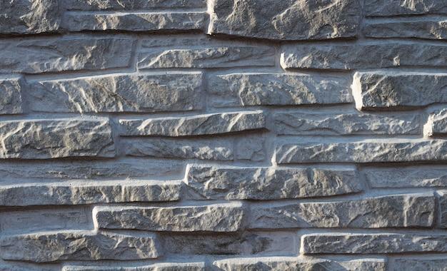 Tekstura dekoracyjna biała łupkowa kamiennej ściany powierzchnia