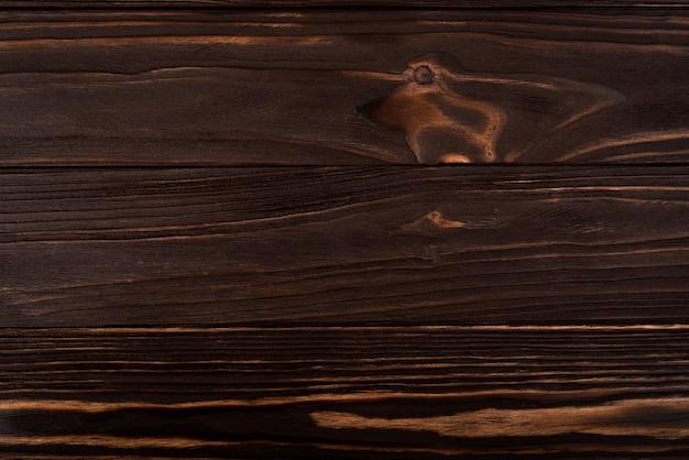 Tekstura drewna. powierzchni ciemnego drewna tekowego tła do projektowania i dekoracji.