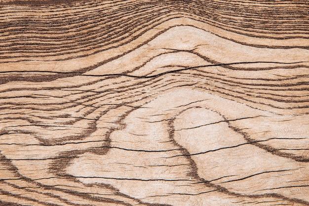 Tekstura drewna. tło drewna do projektowania i dekoracji. drewniana deska naturalna w kolorze brązowym